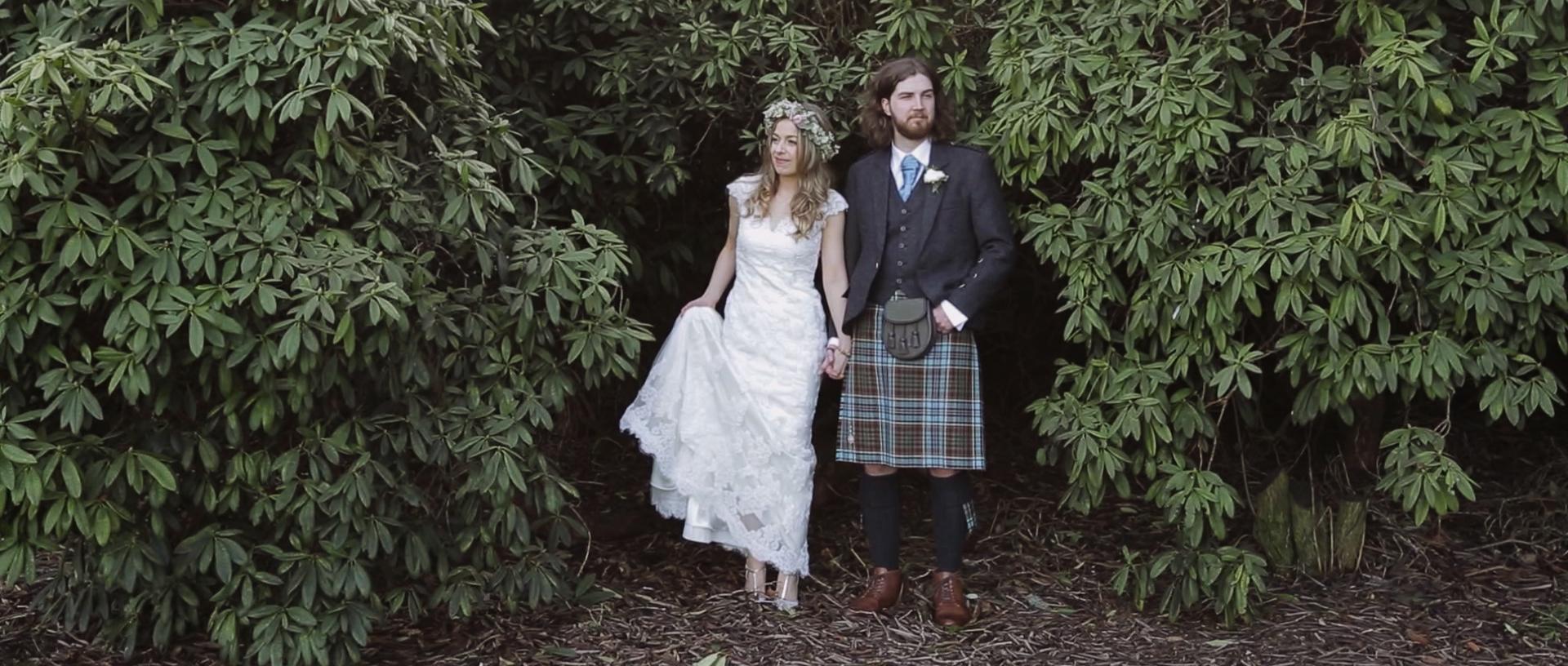 Scottish bride and groom posing for a photo on their wedding day at Dalmahoy Hotel Edinburgh.