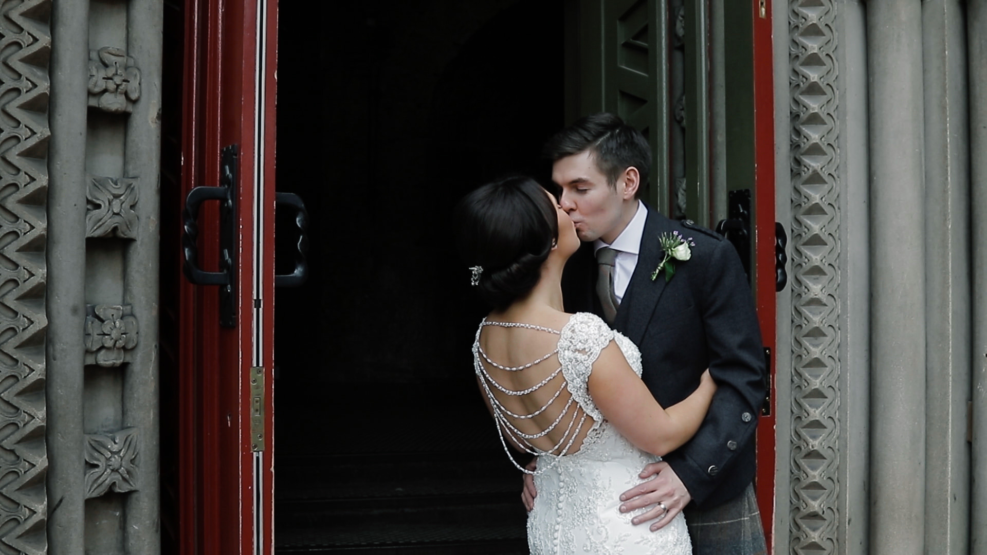 Wedding couple kissing in the entrance door to the Ghillie Dhu in Edinburgh