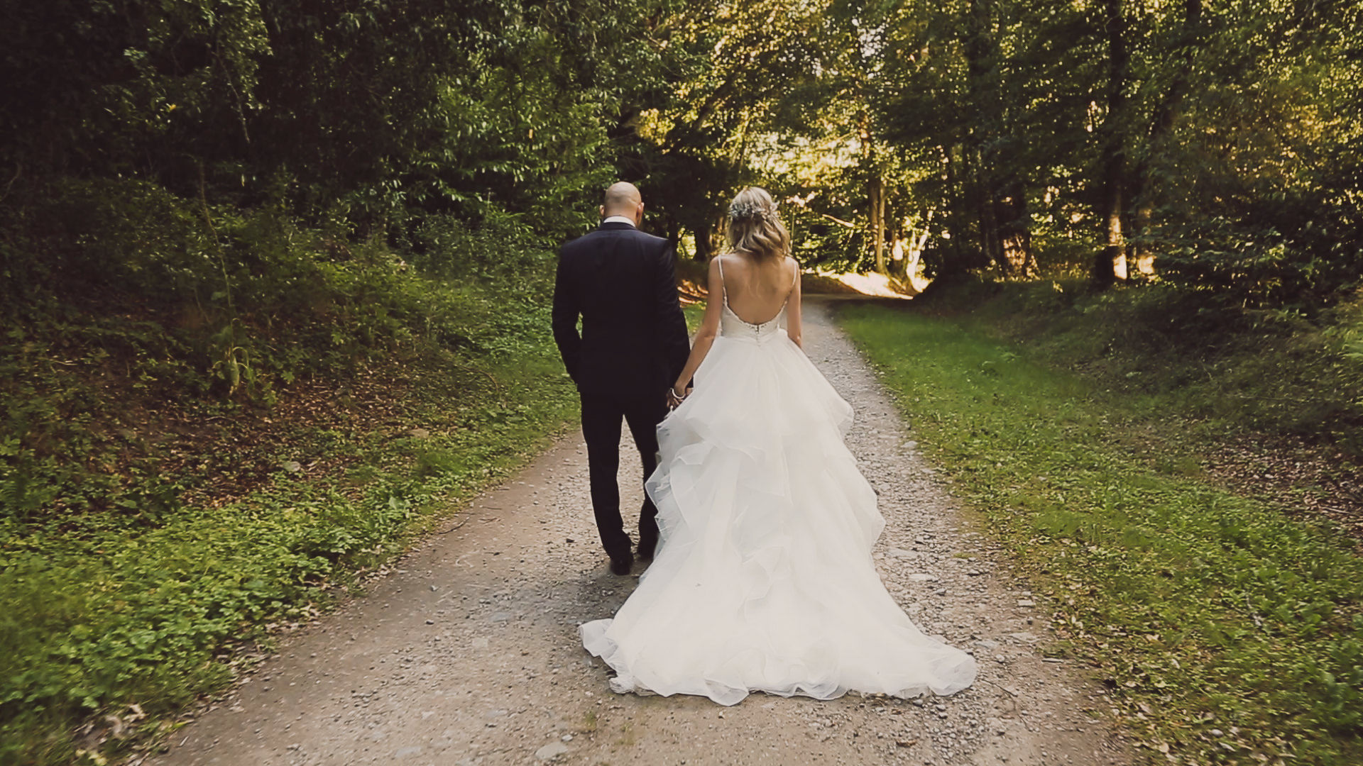 Groom and bride walking at Achnagairn Estate Inverness. Image by a wedding videographer.